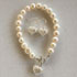 All pearl bracelet with filigree silver heart £69 and earrings £39
